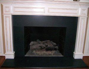 Granite fireplace absolute blackat Edge Stoneworks