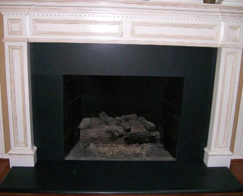 Granite fireplace absolute black at Edge Stoneworks