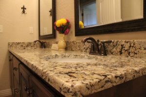 Granite vanity guest bathroom by Edge Stoneworks